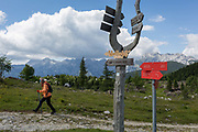 Hiking route markers in Velika Planina, on 26th June 2018, in Velika Planina, near Kamnik, Slovenia. Velika Planina is a mountain plateau in the Kamnik–Savinja Alps - a 5.8 square kilometres area 1,500 metres 4,900 feet above sea level. Otherwise known as The Big Pasture Plateau, Velika Planina is a winter skiing destination and hiking route in summer. The herders huts became popular in the early 1930s as holiday cabins known as bajtarstvo but these were were destroyed by the Germans during WW2 and rebuilt right afterwards by Vlasto Kopac in the summer of 1945.