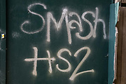 Graffiti reading 'Smash HS2' sprayed on boards around a construction site for the HS2 high-speed rail link in the Colne Valley is pictured on 11 September 2020 in Denham Green, United Kingdom. Anti-HS2 activists continue to try to prevent or delay works on the controversial £106bn HS2 high-speed rail link from a series of protection camps based along the route of the line between London and Birmingham.