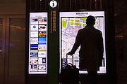 A man in silhouette looks at an information board in Tokyo Station, Tokyo, Japan Friday January 30th 2015.