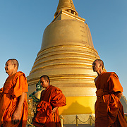 Monks walking past stupa at Wat Saket, Bangkok