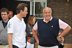 Left to right, DOUGRAY SCOTT and STEPHEN MARKS at the Mini Masters Golf tournament in aid of LEUKA - London's celebrity golf tournament held at Duke's Meadow Golf Club, Dan Mason Drive, London W4 on 17th July 2009.