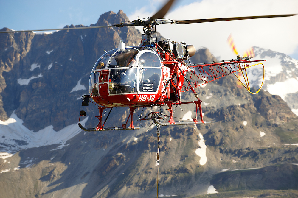 Mountain helicopter over Furgg , Zermatt , .<br /> <br /> Visit our SWITZERLAND  & ALPS PHOTO COLLECTIONS for more  photos  to browse of  download or buy as prints https://funkystock.photoshelter.com/gallery-collection/Pictures-Images-of-Switzerland-Photos-of-Swiss-Alps-Landmark-Sites/C0000DPgRJMSrQ3U