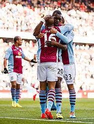 Aston Villa Forward Christian Benteke (BEL) hugs Midfielder Fabian Delph (ENG) and Defender Ryan Bertrand (ENG) as he celebrates scoring a goal - Photo mandatory by-line: Rogan Thomson/JMP - 07966 386802 - 23/03/2014 - SPORT - FOOTBALL - Villa Park, Birmingham - Aston Villa v Stoke City - Barclays Premier League.