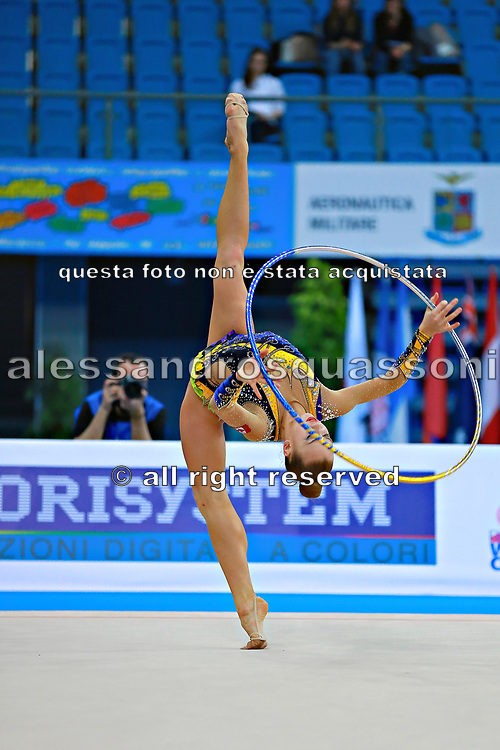 Bezzoubenko Patricia during qualifying at hoop in Pesaro World Cup 10 April 2015.<br /> Patricia was born on 21 February, 1997 a retired individual Canadian rhythmic gymnast.