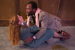 "© Licensed to London News Pictures. 15/01/2014. London, England. Stefan Adegbola as Othello and Gillian Saker as Desdemona. The Shakespearean tragedy ""Othello: The Moor of Venice"" opens at the Riverside Studios in Hammersmith, London in a ""Film Noir"" setting. Directed by Rebekah Fortune with Stefan Adegbola as Othello and Gillian Saker as Desdemona. Running form 15 January to 18 February 2014. Photo credit: Bettina Strenske/LNP"