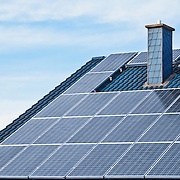 Photovoltaic solar panels mounted on the roof of a German house.<br /> <br /> LICENSING: This image can only be licensed through SpacesImages. Click on the link below:<br /> <br /> http://tinyurl.com/d8k3lgw