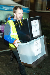 © Licensed to London News Pictures . 12/12/2019. Bury, UK. The first ballot boxes arrive at the count for seats in the constituency of Bury South in the 2019 UK General Election , at Castle Leisure Centre in Bury . Photo credit: Joel Goodman/LNP