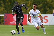 Hawke's Bay United's Manyumow Achol makes a break past Auckland City FC's Cam Howieson in the Handa Premiership football match, Hawke's Bay United v Auckland City FC, Bluewater Stadium, Napier, Sunday, January 31, 2021. Copyright photo: Kerry Marshall / www.photosport.nz