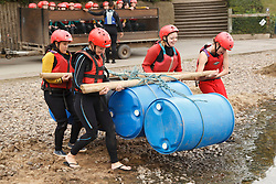 Visually impaired people doing rafting activity at the National Water Sports Centre, launching a raft.
