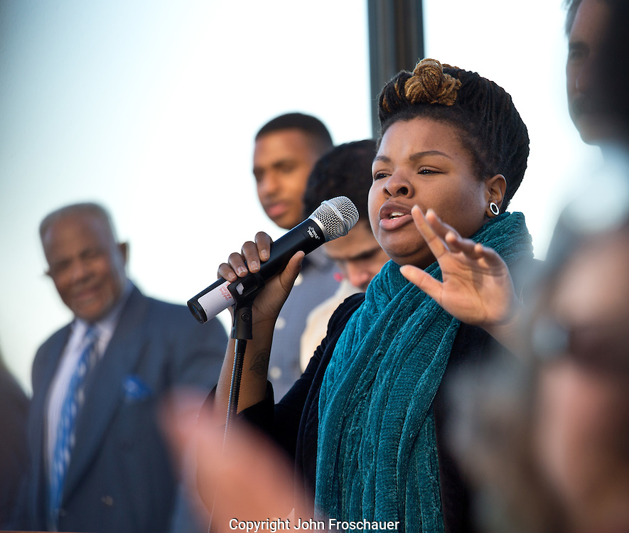 """Stephanie Ann Johnson leads the crowd singing """"We Shall Overcome"""" after marching across the 11th St. bridge in Tacoma in honor of the 50th anniversary of the """"Bloody Sunday"""" march in Selma Alabama, on Sunday, March 8, 2015. (Photo/John Froschauer)"""