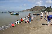Group of expatriate Australians with a group of Vietnamese orphans at the seaside. Bai Truoc (Front Beach, aka Tam Duong beach or Hang Dua bay), Vung Tau, Vietnam
