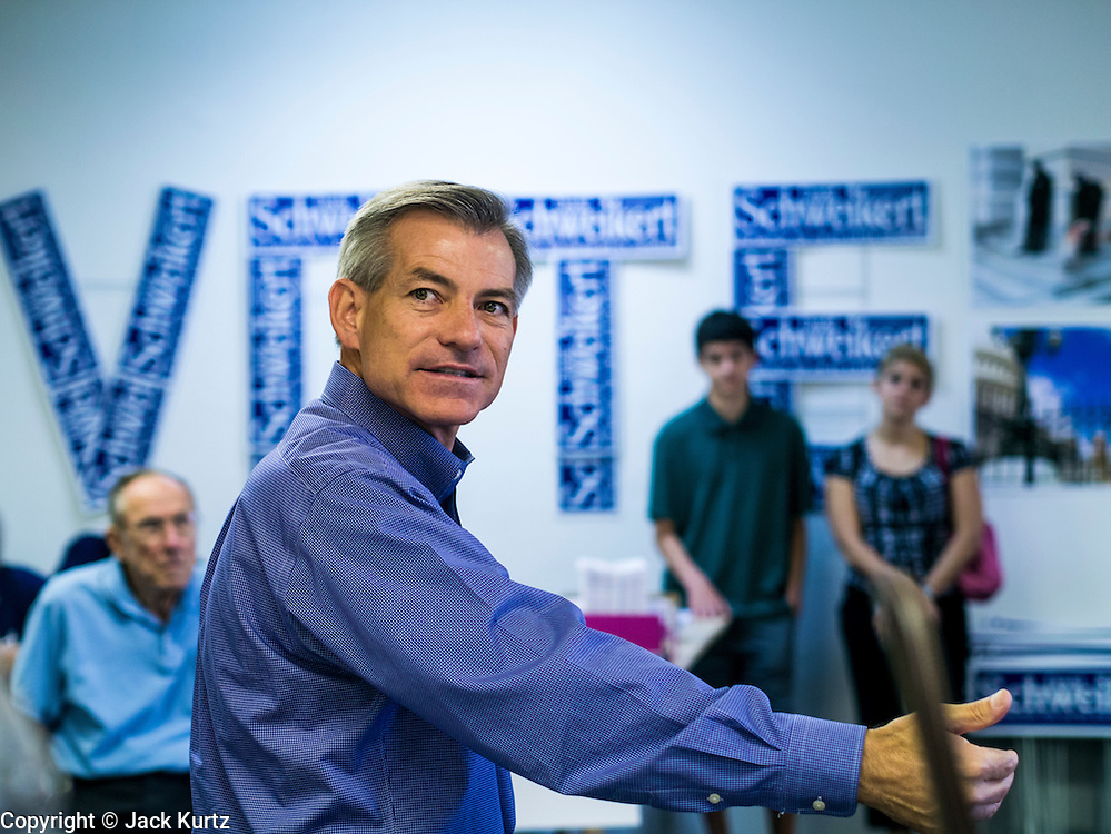 """02 JUNE 2012 - PHOENIX, AZ:   Congressman DAVID SCHWEIKERT (R-AZ) talks to campaign volunteers Saturday in front of a sign that says """"vote."""" Schweikert met with his campaign staff and volunteers for a pancake breakfast Saturday morning at the campaign headquarters to talk to them about the upcoming primary election against fellow Republican Ben Quayle. Republican incumbents Schweikert and Quayle will face each other in Arizona's Aug. 28 primary election. Redistricting because of the census has thrown the two conservative freshman Republican Congressmen into Arizona's 6th Congressional District. The district is made up of mostly upper middle class neighborhoods in north Phoenix and the wealthy suburban communities of Scottsdale, Fountain Hills and Cave Creek. The District is strongly Republican and whoever wins the Republican primary is expected to easily win November's general election.       PHOTO BY JACK KURTZ"""