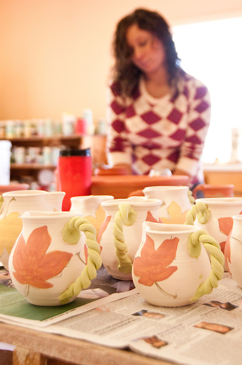 Glazing and painting at LaTulip Pottery and Tile Works in Garden Michigan.