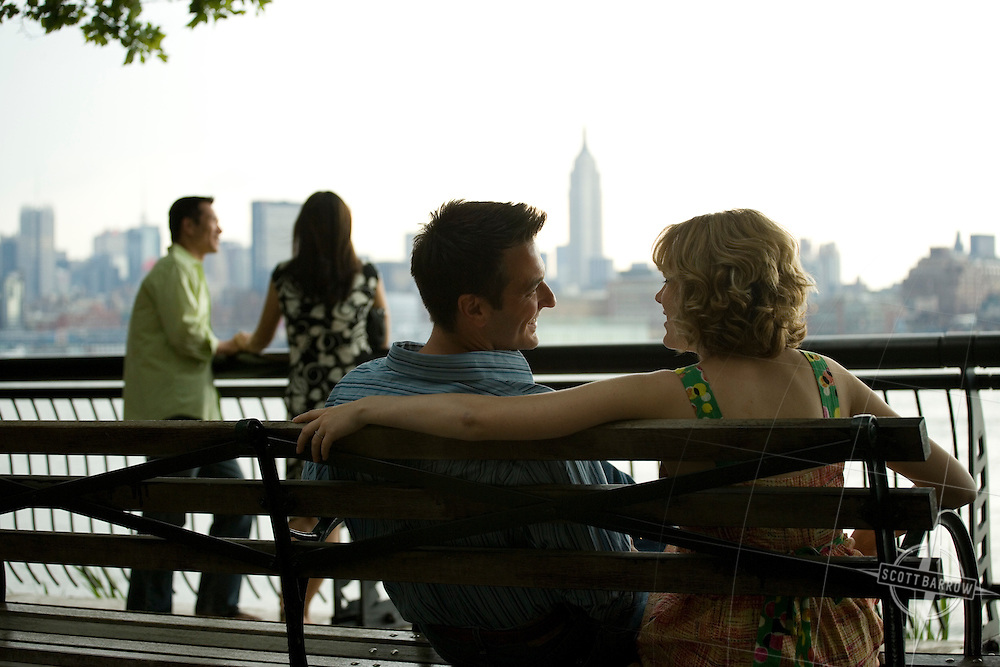 A couple enjoying the view of Manhattan from the Hoboken, New Jersey Promenade.