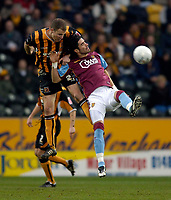 Photo: Jed Wee.<br />Hull v Aston Villa. The FA Cup. 07/01/2006.<br />Aston Villa's Juan Pablo Angel (R) loses out to Hull's Sam Collins.