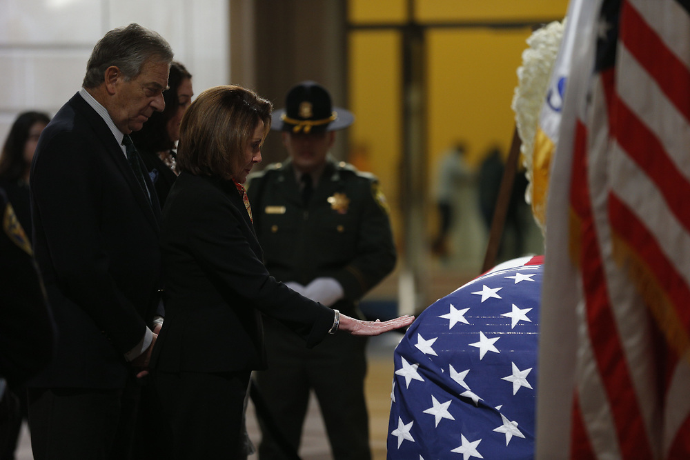 Paul Pelosi and Nancy Pelosi pay their respect as San Francisco Mayor Ed Lee lies in state at City Hall on Friday, Dec. 15, 2017, in San Francisco, Calif. Lee died on Tuesday from a heart attack. He was 65 years old.