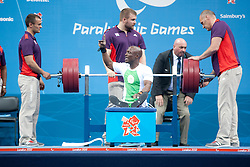 © London News Pictures. 30/08/2012. Excel Centre, London. Nigerian paralympic powerlifter Yakubu Adesokan breaks the world record for the -48kg category now set at 180kg during the Paralympic Games in London 2012 . Photo credit should read Manu Palomeque/LNP