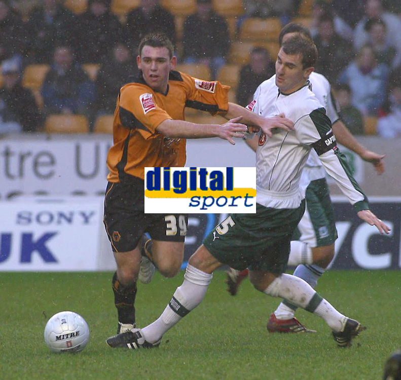 Photo: Dave Linney.<br />Wolverhampton Wanderers v Plymouth Argyle. The FA CupWolves .Mark Davies(L) beats  Paul  Wotton to the ball.<br />07/01/2006.