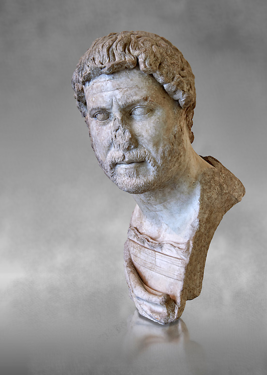 Roman marble portrait bust of Emperor Hadrian, 117-138 AD found in the Horti Tauriani, Rome.  The bust portrays an elderly Hadrian with a well worn expression from around 130AD. An enthusiastic builder Hadrian rebuilt the Pantheon and constructed the Temple of Venus and Roma as well as building Hadrian's Wall, which marked the northern limit of Roman Britain. His villa at Tivoli also showed Hadrian passion for water and Roman baths. Hadrian was regarded by some as a humanist and was philhellene in most of his tastes. He is regarded as one of the Five Good Emperors.  MC inv 890, Capitoline Museums, Rome ..<br /> <br /> If you prefer to buy from our ALAMY STOCK LIBRARY page at https://www.alamy.com/portfolio/paul-williams-funkystock/greco-roman-sculptures.html . Type -    Capitoline    - into LOWER SEARCH WITHIN GALLERY box - Refine search by adding a subject, place, background colour, etc.<br /> <br /> Visit our ROMAN WORLD PHOTO COLLECTIONS for more photos to download or buy as wall art prints https://funkystock.photoshelter.com/gallery-collection/The-Romans-Art-Artefacts-Antiquities-Historic-Sites-Pictures-Images/C0000r2uLJJo9_s0