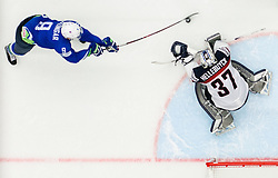 Tomaz Razingar of Slovenia vs Connor Hellebuyck of USA during Ice Hockey match between Slovenia and USA at Day 10 in Group B of 2015 IIHF World Championship, on May 10, 2015 in CEZ Arena, Ostrava, Czech Republic. Photo by Vid Ponikvar / Sportida