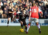 Photo: Alan Crowhurst.<br />Swindon Town v Swansea City. Coca Cola League 1.<br />31/12/2005. <br />Leon Britton (L) attacks for Swansea.