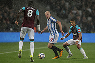 Aaron Mooy of Huddersfield Town is closed down by Chicharito of West Ham utd. Premier league match, West Ham Utd v Huddersfield Town at the London Stadium, Queen Elizabeth Olympic Park in London on Monday 11th September 2017.<br /> pic by Kieran Clarke, Andrew Orchard sports photography.