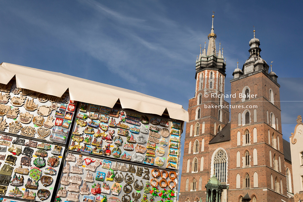Tourist trinkets on sale at a kiosk beneath the towers of the Church of St Mary on Rynek Glowny market square, on 23rd September 2019, in Krakow, Malopolska, Poland.