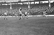Kerry kicks the ball towards the goal as Dublin attempts to block it during the All Ireland Senior Gaelic Football Semi Final, Dublin v Kerry in Croke Park on the 23rd of January 1977. Dublin 3-12 Kerry 1-13.