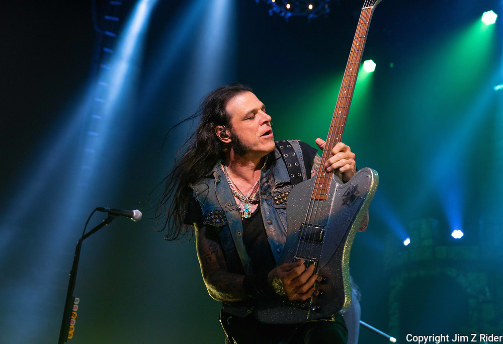 Base player CHUCK GARRIC performs with Alice Cooper.  After nearly 19 months off stage, Rock and Roll legend Alice Cooper, 73, launches his fall 2021 tour at Ocean Casino Resort in Atlantic City, New Jersey.