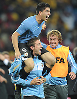 Fotball<br /> Foto: imago/Digitalsport<br /> NORWAY ONLY<br /> <br /> JOHANNESBURG, July 2, 2010   -  Luis Suarez (top) of Uruguay (blue)  celebrates with teammate Sebastian Eguren after winning penalty shootout of the 2010 World Cup quarterfinal soccer match against Ghana at Soccer City stadium in Johannesburg,  on July 2, 2010.