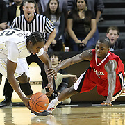 Central Florida guard/forward Isaiah Sykes (32) and Louisiana's forward Bryant Mbamalu (0) scramble for the ball during their game at the UCF Arena on December 15, 2010 in Orlando, Florida. UCF won the game79-58. (AP Photo/Alex Menendez)