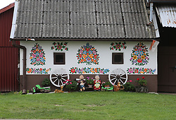 NO WEB/NO APPS - A cottage in the painted village of Zalipie, Poland on September 2, 2017. Located 100 km from Krakow near the confluence of the Wisła and Dunajec rivers, Zalipie is a peaceful agricultural village, very unique because of colorful flower paintings all over the walls of wooden houses, fences, wells, which makes you feel like in a fairy tale. Since the late 19th century, the women of Zalipie have been painting their homes inside and out with bright, floral patterns. The custom developed in the days before chimneys when the smoke from the cottage hearths would slowly blacken the interior walls. To prepare the home for important religious holidays, the proud wives of the village would repaint the walls with white lime. By the time progress and its new fan-dangled 'chimneys' arrived in Zalipie the tradition had not only stuck, but, with the aid of coloured paints, it had evolved into a unique art form that saw the village cottages adorned inside and out in extraordinary floral folk motifs. By the 1930s, the village had made a bit of a name for itself and in 1948, the first competition to select the most beautifully decorated cottage was held—a tradition that continues annually to this day on the weekend after Corpus Christi. Photo by Somer/ABACAPRESS.COM