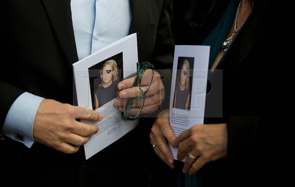 © Licensed to London News Pictures. 16/05/2012. London, UK. Guests holding service books leaving St Martin in the Fields church, London following a memorial service held for American Sunday Times journalist Marie Colvin, who died covering the siege of Homs in Syria.  Photo credit : Ben Cawthra/LNP