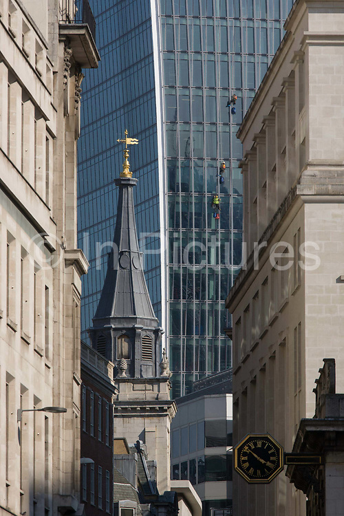City banks and other financial institutions along Lombard Street, London. In the distance is a team of window cleaners attending to the new Walkie Talkie building, whose plate glass surfaces require attention high above London's streets. The steeple to the left is the Anglican St Edmund, King and Martyr. Lombard Street, originally a piece of land granted by King Edward I to goldsmiths from the part of northern Italy known as Lombardy (larger than the modern region of Lombardy). It is a narrow and usually dark sidestreet near the Bank of England in the heart of what is called the Square Mile - the inner-part and oldest quarter of London occupied first by the Romans 2,000 years ago. Nowadays the City of London is home to banks and financial institutions but also with a resident population of under 10,000 but a daily working population of 311,000.