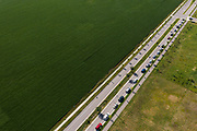 Hundreds of cars line up near Prairie Winds Middle School in Mankato, Minnesota, U.S. for a pop up grocery event on Thursday, July 23, 2020. Photographer: Ben Brewer/Bloomberg
