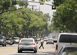 June 19, 2017 - Santa Ana, CA, USA - A pedestrian crosses Civic Center Drive on Lacey near Saint Joseph School where a woman died after being hit by a car Saturday evening as she crossed Civic Center Drive in downtown Santa Ana, CA on Monday, June 19, 2017. (Credit Image: © Ken Steinhardt/The Orange County Register via ZUMA Wire)