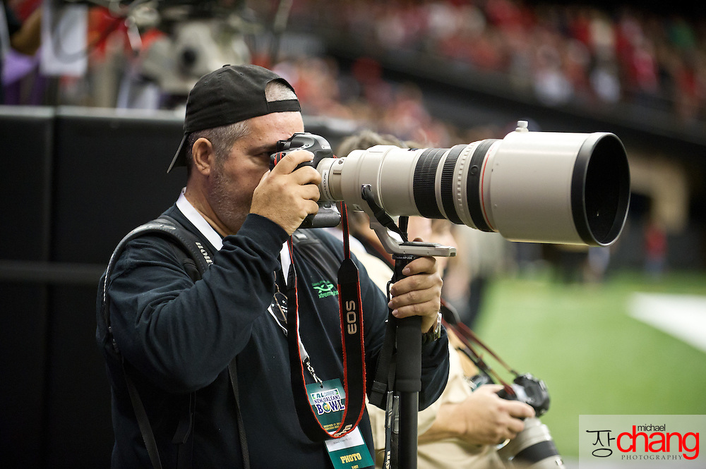 Mississippi based sports photographer, Bobby McDuffie during the R+L Carriers New Orleans Bowl at the Mercedes-Benz Superdome.  Louisiana-Lafayette defeated San-Diego State 32-30. (Copyright Michael Chang).