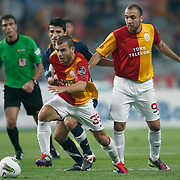 Galatasaray's Yekta KURTULUS (F) and Sercan YILDIRIM (R) during their Turkish soccer superleague match Istanbul BBSpor between Galatasaray at the Ataturk Olympic stadium in Istanbul Turkey on Sunday 11 September 2011. Photo by TURKPIX