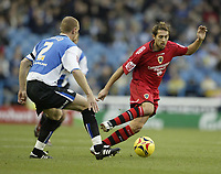 Photo: Aidan Ellis.<br /> Sheffield Wednesday v Cardiff City. Coca Cola Championship. 25/11/2006.<br /> Cardiff's Michael Chopra (R) causes problems for ednesday's Lee Bullen