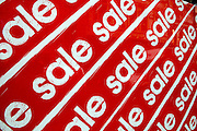 A sale sign in a store window