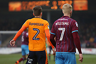 Scunthorpe United forward Luke Williams (7) and Oldham Athletic defender Cameron Dummigan (2) during the EFL Sky Bet League 1 match between Scunthorpe United and Oldham Athletic at Glanford Park, Scunthorpe, England on 3 March 2018. Picture by Mick Atkins.
