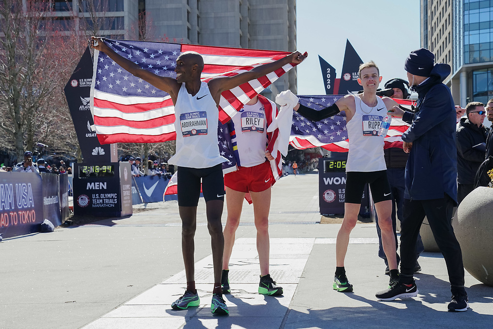 Abdi Abdirahman and Galen Rupp celebrate placing third during the 2020 U.S. Olympic marathon trials in Atlanta on Saturday, Feb. 20, 2020. Photo by Kevin D. Liles for The New York Times