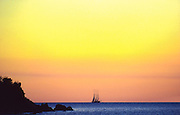 A three masted schooner off St. John Island, U.S. Virgin Islands, dusk.