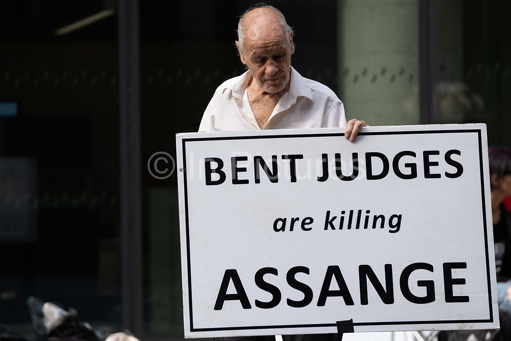 A supporter of Wikileaks founder Julian Assange protests outside London's Old Bailey court as his fight against extradition to the US has resumed, on 16th September 2020, in London, England. Assange has been in Belmarsh Prison for 16 months and is wanted over the publication of classified documents in 2010 and 2011. If convicted in the US, he faces a possible penalty of 175 years in jail.