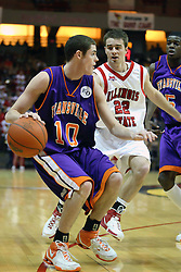 30 January 2007: Taylor Morrow drives around Julius Moor. The Purple Aces of Evansville folded the final 2 minutes of play and handed the game to Illinois State University Redbirds by a score of 65-61at Redbird Arena in Normal Illinois.