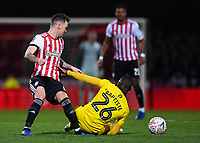 Football - 2018 / 2019 FA Cup - Third Round: Brentford vs. Oxford United<br /> <br /> Oxford United's Shandon Baptiste goes down under a challenge from Brentford's Josh McEachran leading to him being stretchered off, at Griffin Park.<br /> <br /> COLORSPORT/ASHLEY WESTERN
