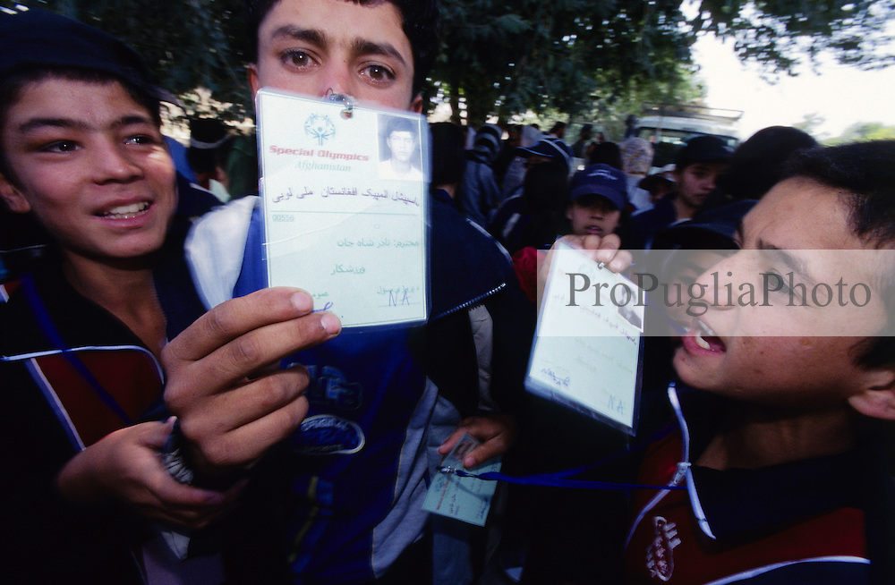 AFGHANISTAN..Kabul, 23 August 2005..Disability National Games, torch run from Darul Aman to Ghazi Stadium. Young Afghanis are diplayng their SOA Athlethe's ID