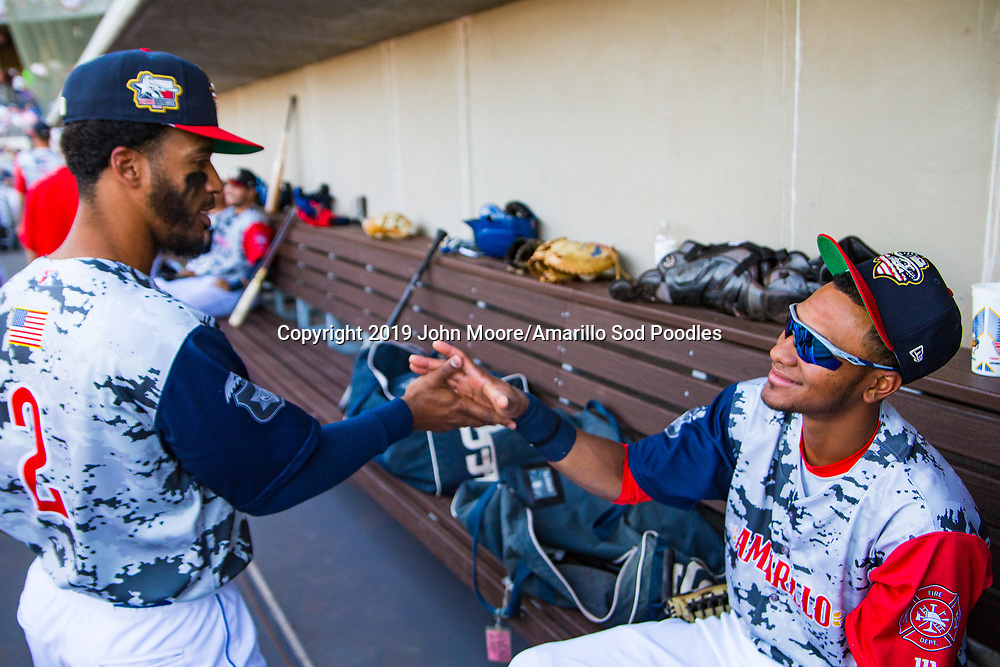 Amarillo Sod Poodles infielder Ivan Castillo (2) and outfielder Edward Olivares (11) before the game against the Corpus Christi Hooks on Thursday, July 4, 2019, at HODGETOWN in Amarillo, Texas. [Photo by John Moore/Amarillo Sod Poodles]