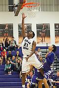 Cedar Ridge's Jerrod Smith jumps high for the basket Friday at Cedar Ridge Gym.  (LOURDES M SHOAF for Round Rock Leader.)