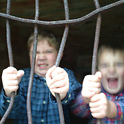 October 20, 2005 --The Waltz brothers play at bending the bars at Fort in Phippsburg during a Family Photojournalism session